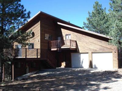What a great opportunity to buy a home within walking distance to the base of the ski area. 4 bedroom and 3 baths plus a large 2 car garage. The living room has a very nice wood burning fire place and a wet bar. Large wrap around deck with very nice views. Large kitchen for the cook in the family.
