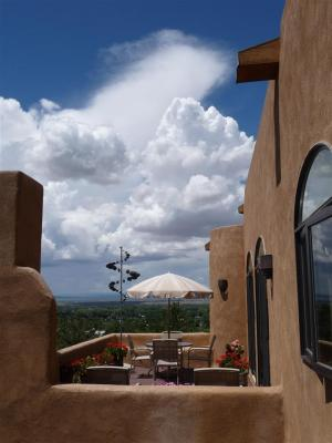 Huge Views! Perched On A Lovely Wooded 2.24 Acre Canon Foothills Lot, This Home With Its Huge Picture Windows, Truly Captures The Panoramic Mountain And Taos Valley Views. Versatile Floorplan: Welcoming Gallery Entry. Great Room W/Fireplace & Dining Area Open To The Kitchen. Elegant Master Suite W/2 Full Baths, Walk In Closet And Patio Access. Library. Guest Bath. Meditation Room. Guest