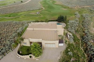 This is a wonderful adobe house located on the Taos country Club golf course. The 3rd green and 4th tee and fairway border the front yard. Spectacular sunsets and beautiful golf course vistas are a daily occurrence, and someone else does the mowing.