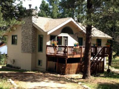 1,820± sq. ft.  3 bedroom, 2½ bath , 1-car garage home on a half acre lot in Angel Fire Resort.  Conveniently located on Armijo Dr. minutes to the Village and Resort amenities.  Two levels with master, guest bedroom, 2 baths, great room and kitchen on the upper level and guest bedroom, ¾ bath and bonus room with private entry downstairs. Granite counter tops, propane central forced air heat and wood burning stove. Furnished with exceptions.