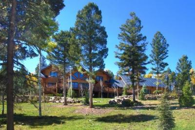 Beautiful Custom Log Home on 5.2 acres in the Aspens Subdivision. This home has four separate living spaces to accommodate large families or groups. A large covered outdoor space with wood burning fireplace available in all seasons. The hot tub on the lower deck has views of the forest. The quality materials, finishes and details accent the large logs used in construction of this mountain home built by the builder for their personal home in 2009. Tastefully landscaped. More info: www.80ViaDelMaria.com